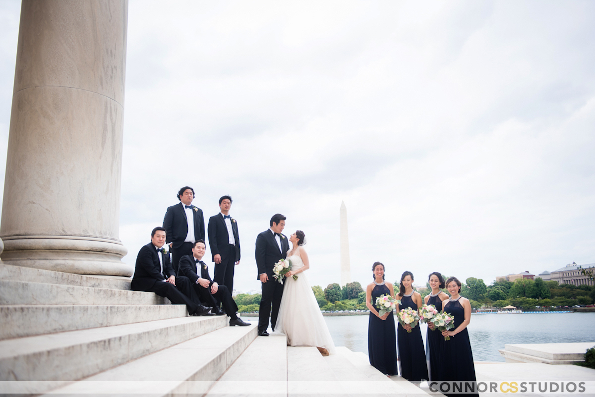 Bridal party posing on steps for picture