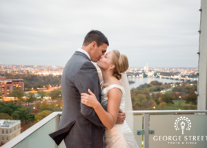 Bride and Groom Kissing On Roof Top At Reception