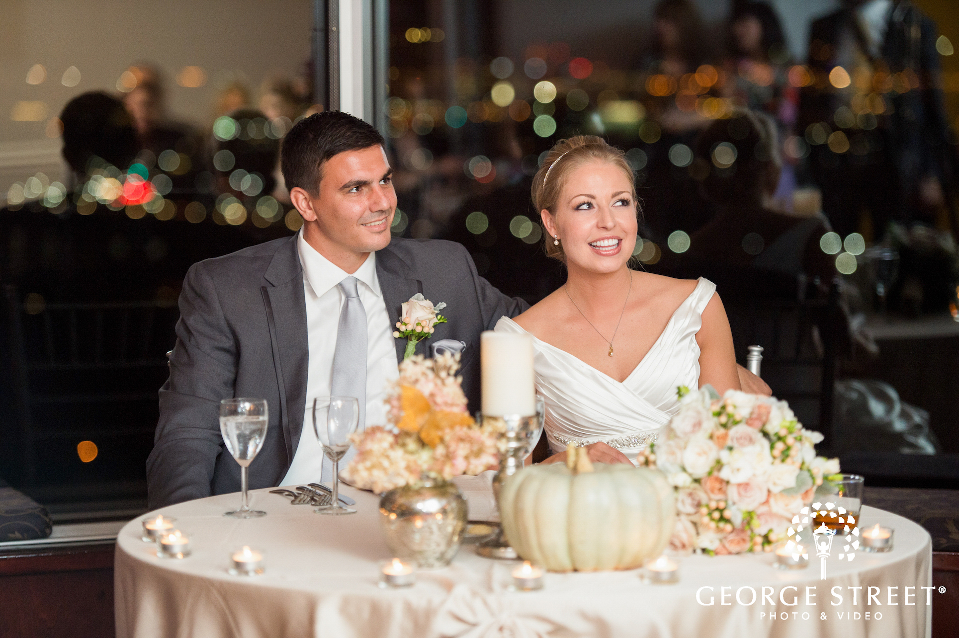 Bride and Groom at A Head Table At Their Reception
