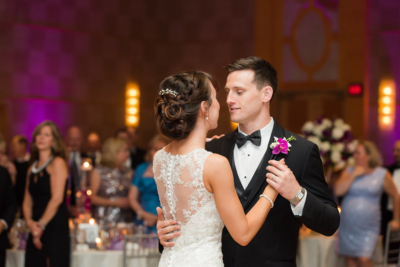 couple slow dancing for the first time as husband and wife