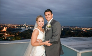 bride and groom posing on roof top at wedding reception planned for by event planning dc
