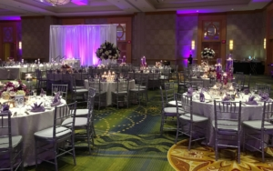 wedding reception with beautiful white roses in centerpieces