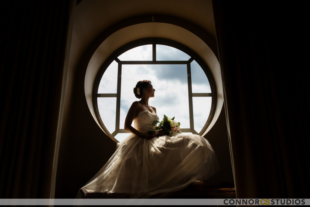Bride posing for picture in a circular window
