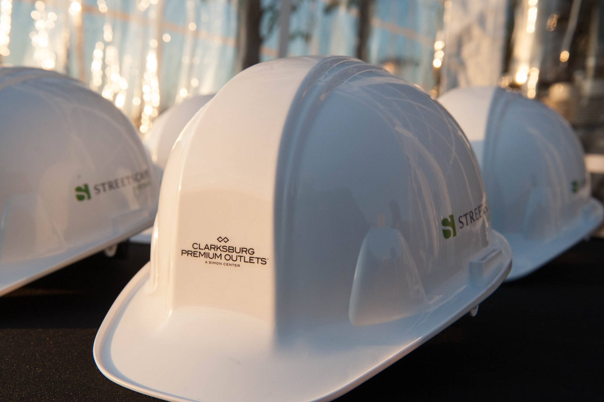 picture of heard hats at ground breaking ceremony